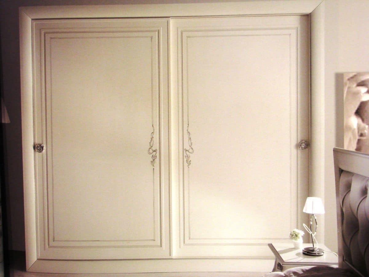Decorazione Ante Armadio : Armadio bianco con ante scorrevoli decorazioni argentate idfdesign
