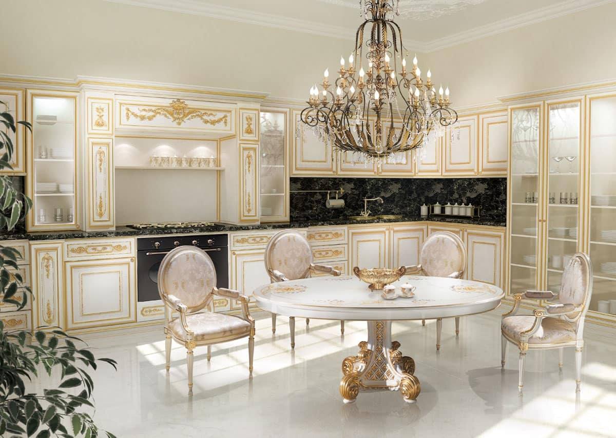Cucina di colore bianco e oro piani in marmo nero idfdesign - Cucine lussuose moderne ...