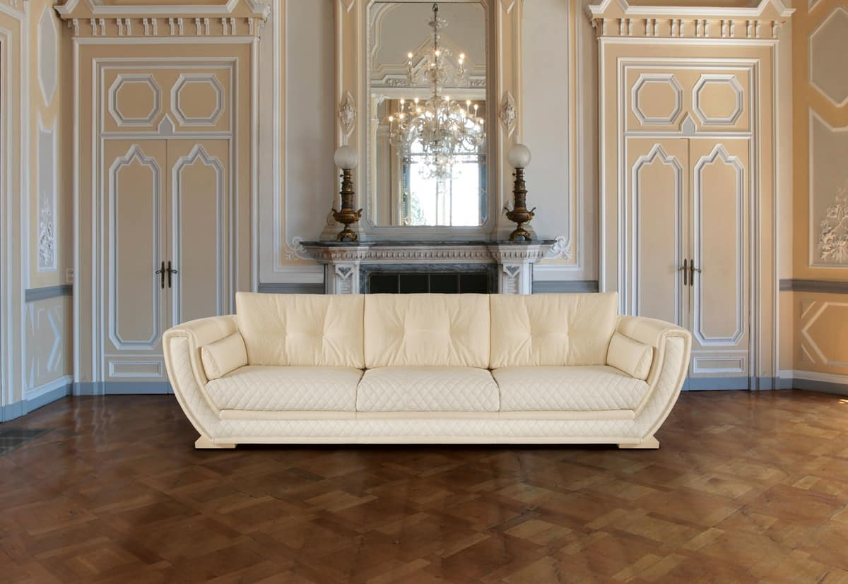 Elegante divano con rivestimento in pelle crema idfdesign - Cambiare rivestimento divano poltrone e sofa ...