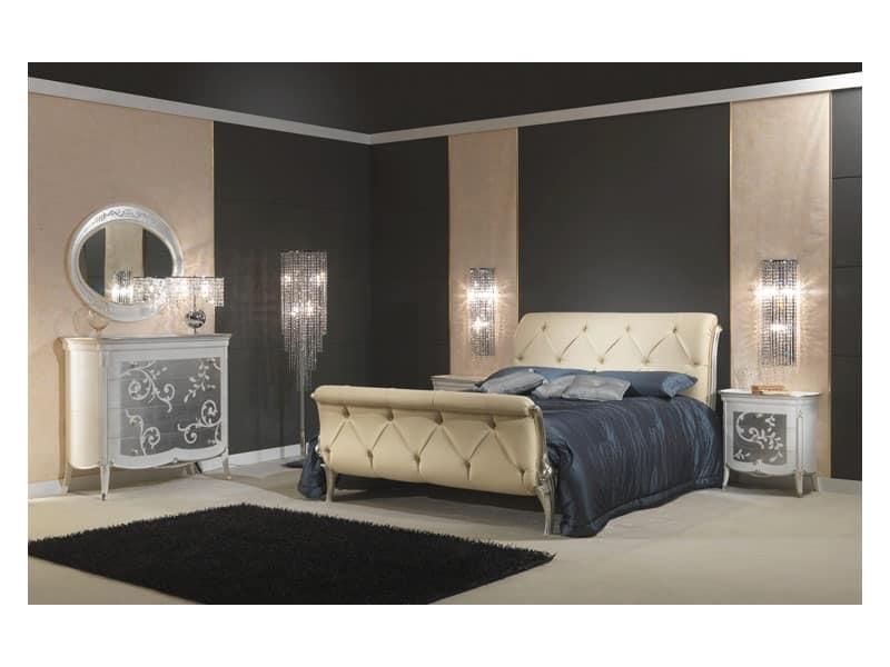 Letto sontuosamente decorato in pelle per camere for Design di mobili in legno letto