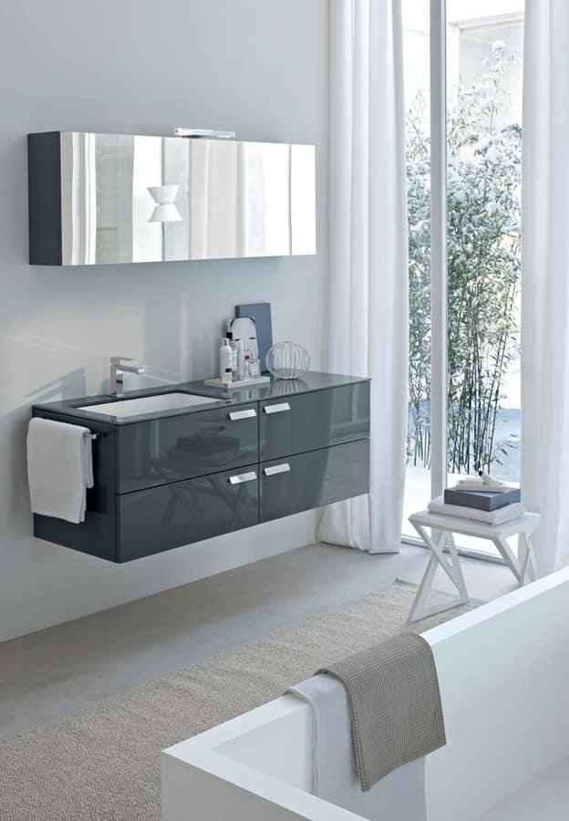 Mobile monoblocco per bagno con piano in cristallo for Arredo bagno design