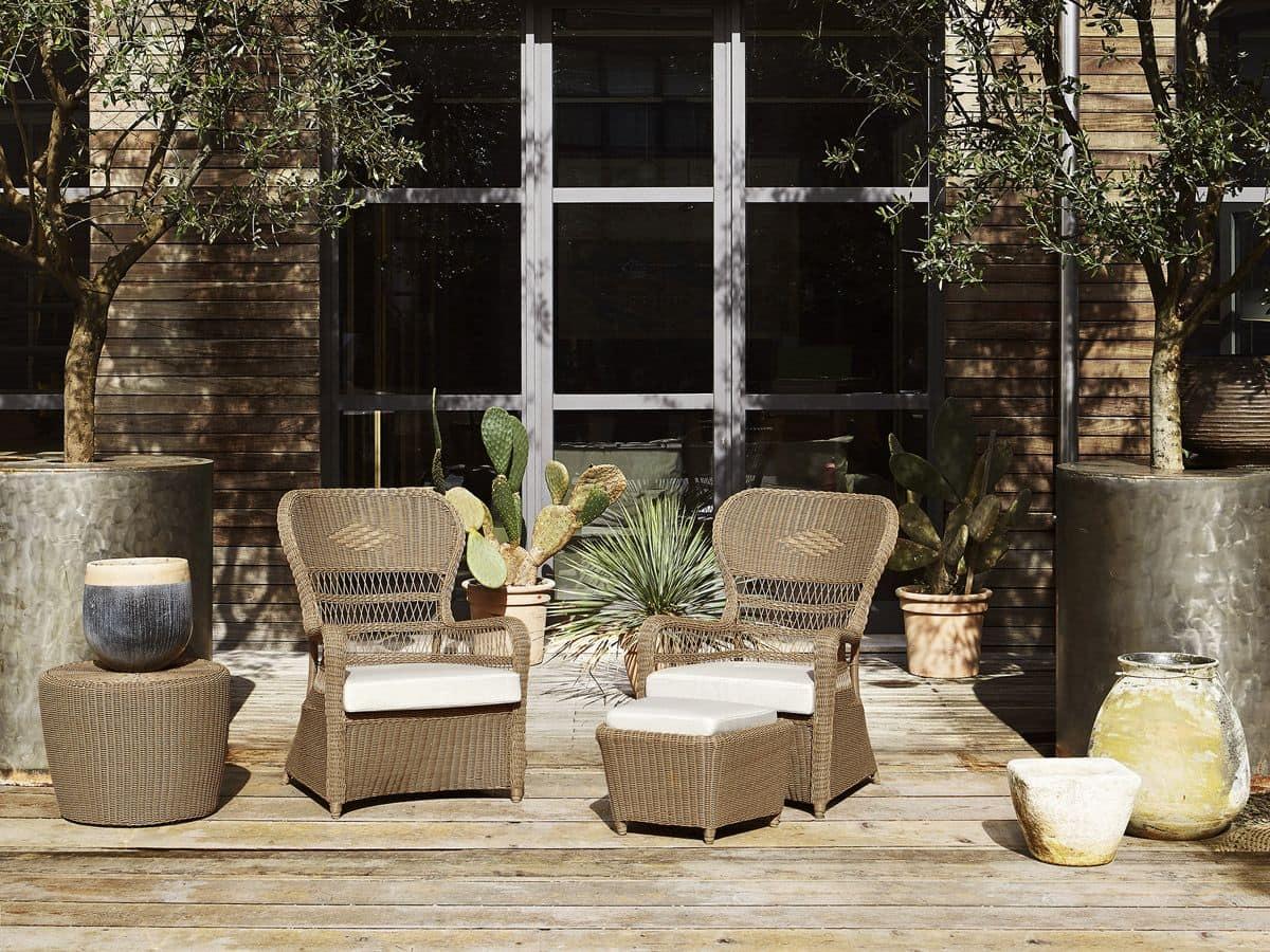 Poltrona intrecciata con cuscini per il terrazzo idfdesign for Poltrona da terrazzo design
