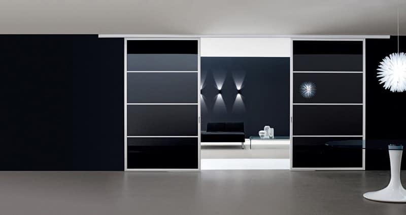 NOMOS porte scorrevoli, Porta scorrevole con binario a parete o a soffitto