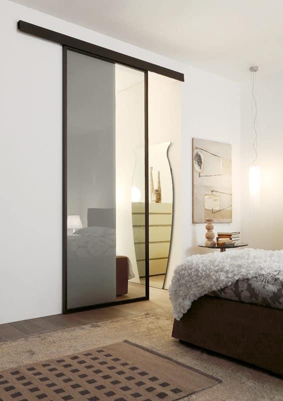 Porta scorrevole in vetro con cornice in alluminio idfdesign - Porta scorrevole alluminio ...
