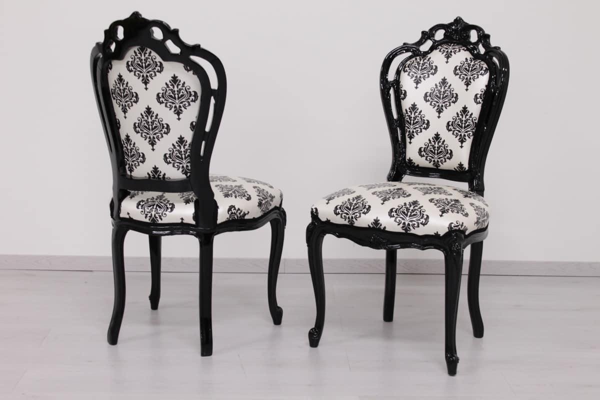 Sedia in legno laccato nero intagliato a mano idfdesign for Sedie contemporanee