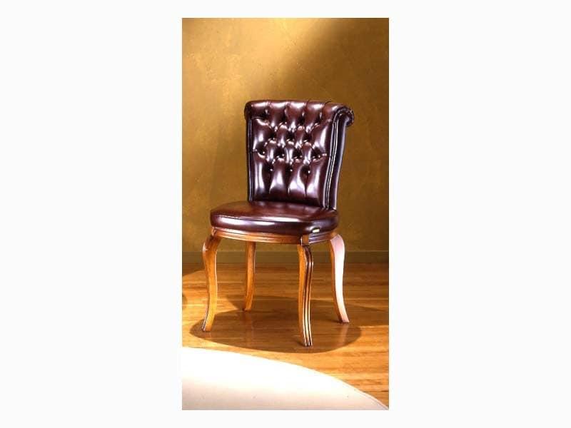 Sedia con schienale capitonn per sale da pranzo idfdesign for Case senza sale da pranzo formali