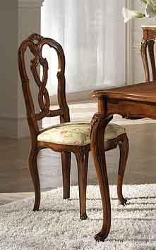 P 601, Sedia in noce con seduta imbottita e schienale intagliato