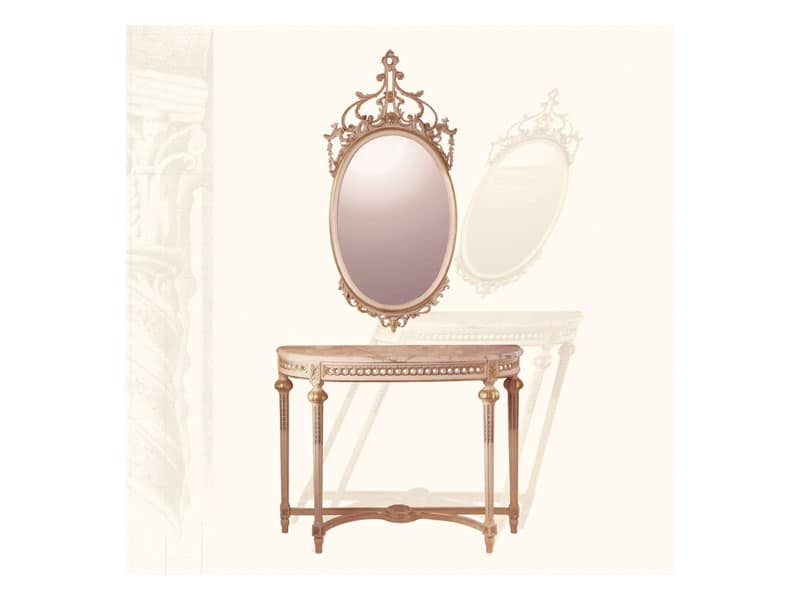Specchiera art. 134, Specchiera ovale con cimasa intagliata, stile Luigi XVI