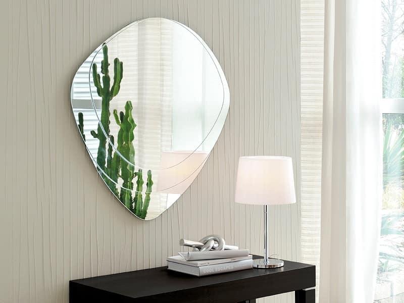 Specchiera dalla forma sagomata per case moderne idfdesign - Specchi particolari da parete ...