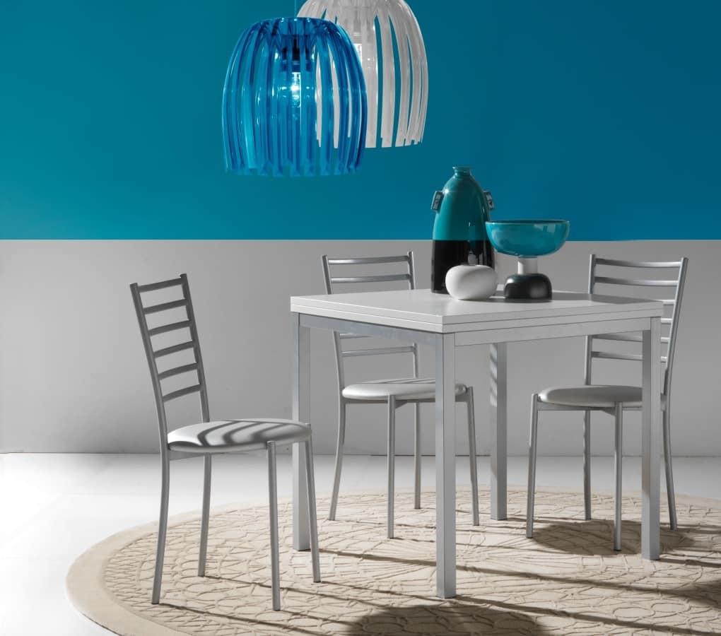 Piccolo tavolo da pranzo con apertura a libro idfdesign for Tavoli contemporaneo design