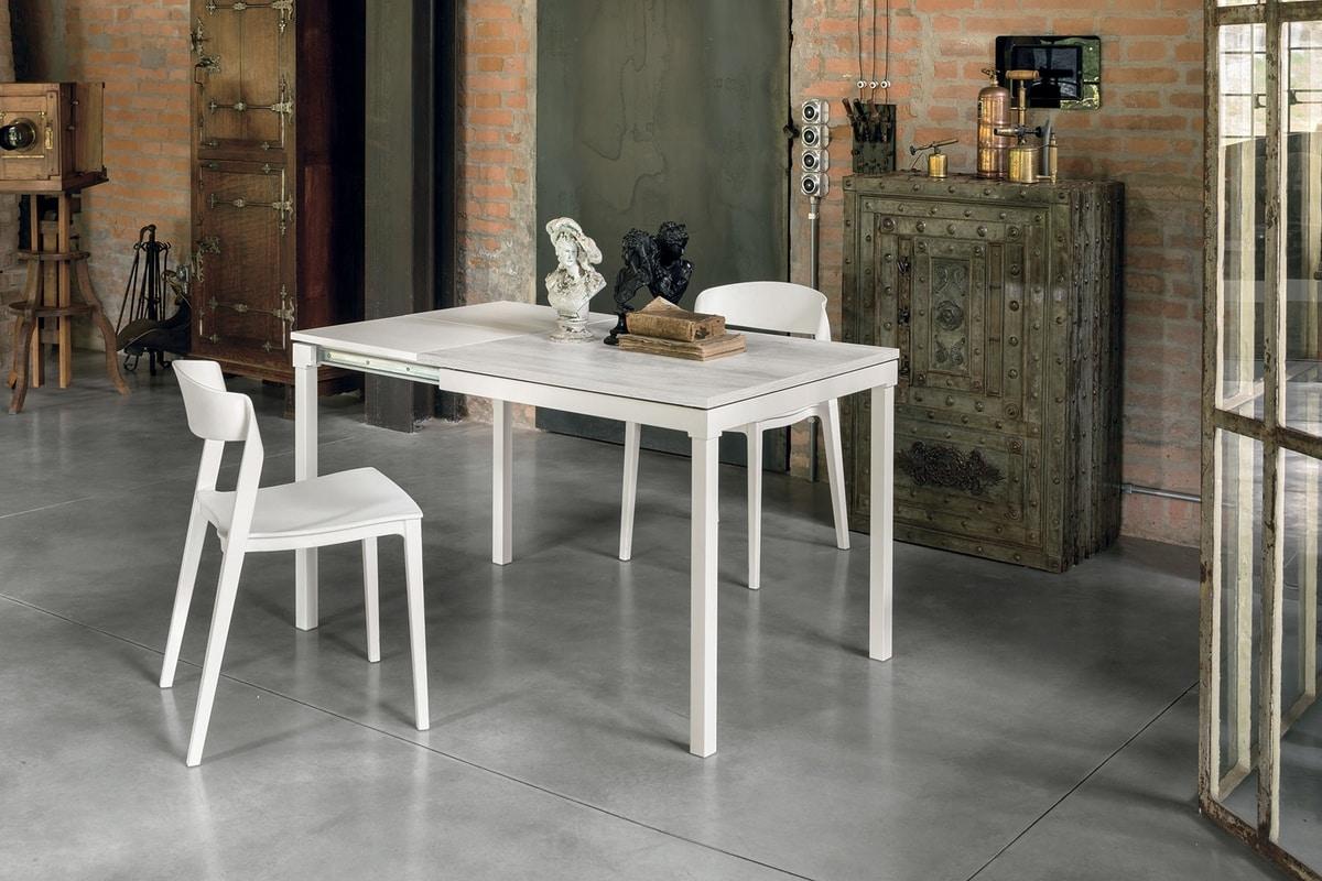 Tavolo allungabile in metallo piano in laminato in stile for Tavolo allungabile moderno