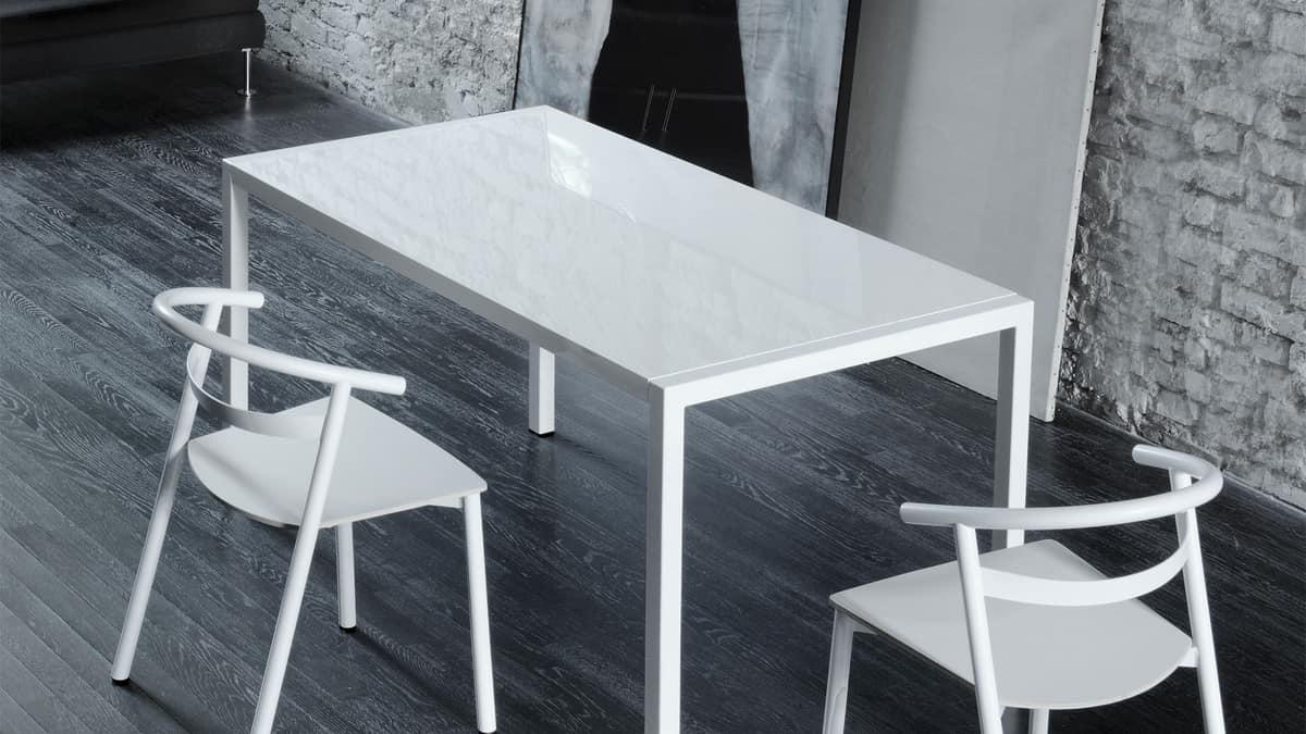 Tavolo allungabile con struttura in acciaio stile for Negozi tavoli milano