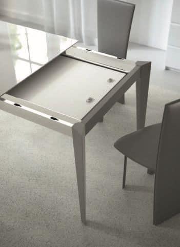 Tavolo allungabile in acciaio e vetro per cucine moderne for Tavoli allungabili in vetro