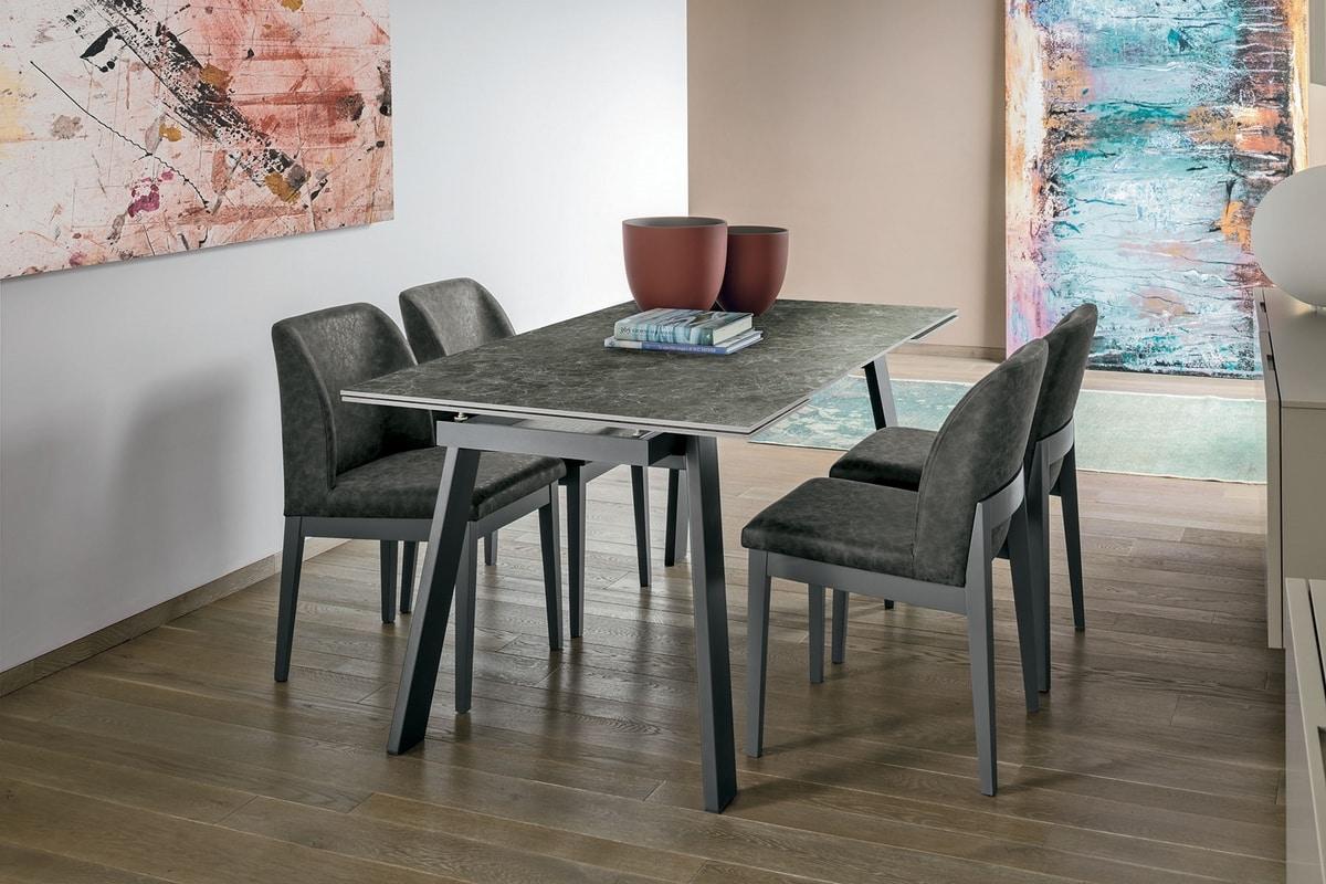 Tavolo allungabile in metallo piano in vetro temperato for Tavoli moderni vetro design