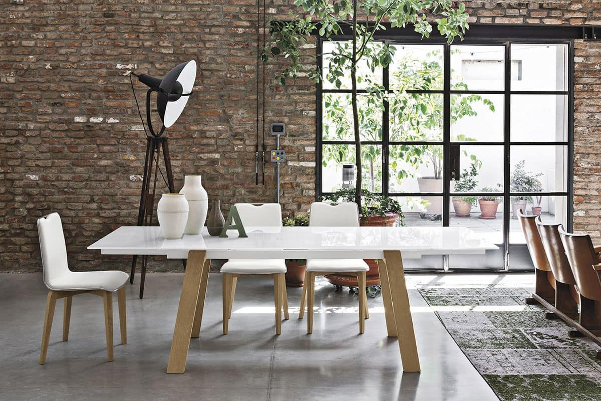 Tavolo allungabile in metallo piano in vetro temperato for Tavoli da sala da pranzo moderni