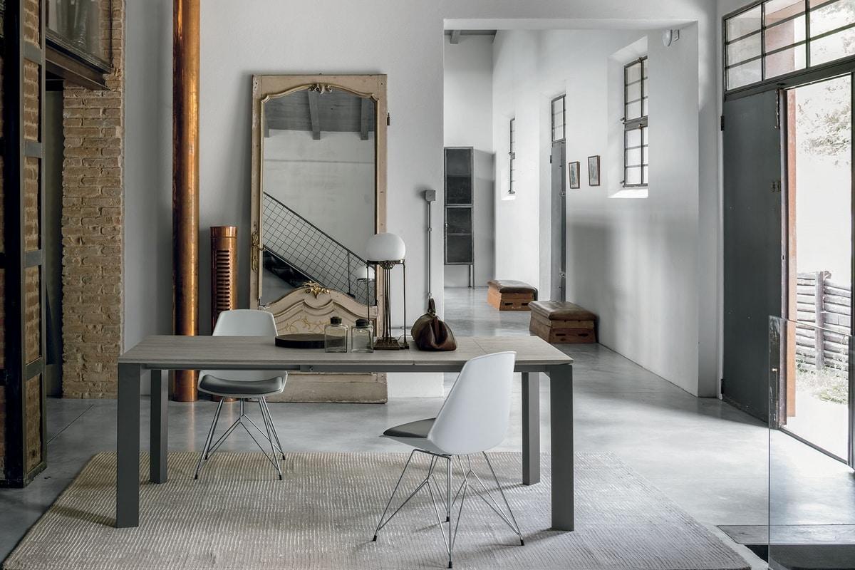 Tavolo allungabile struttura in alluminio piano in vetro for Piani moderni in vetro