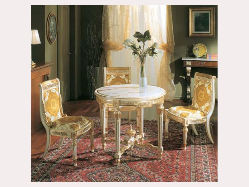 Tavolo tondo con piano in finto marmo legno intagliato a for Tavolo legno piano marmo