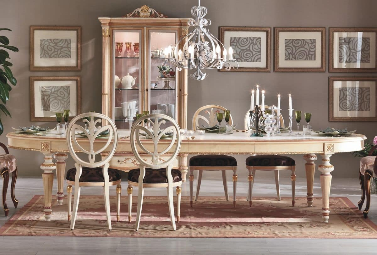 Tavolo allungabile ovale con finiture fatte a mano idfdesign for Le piu belle lampade da tavolo