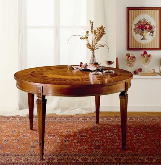 Tavolo tondo allungabile, in legno massiccio intarsiato  IDFdesign