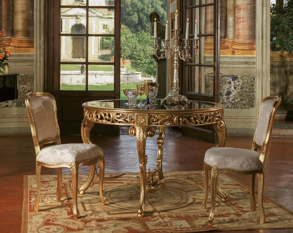 Tavolo in stile classico con piano tondo in vetro idfdesign for Tavolo classico