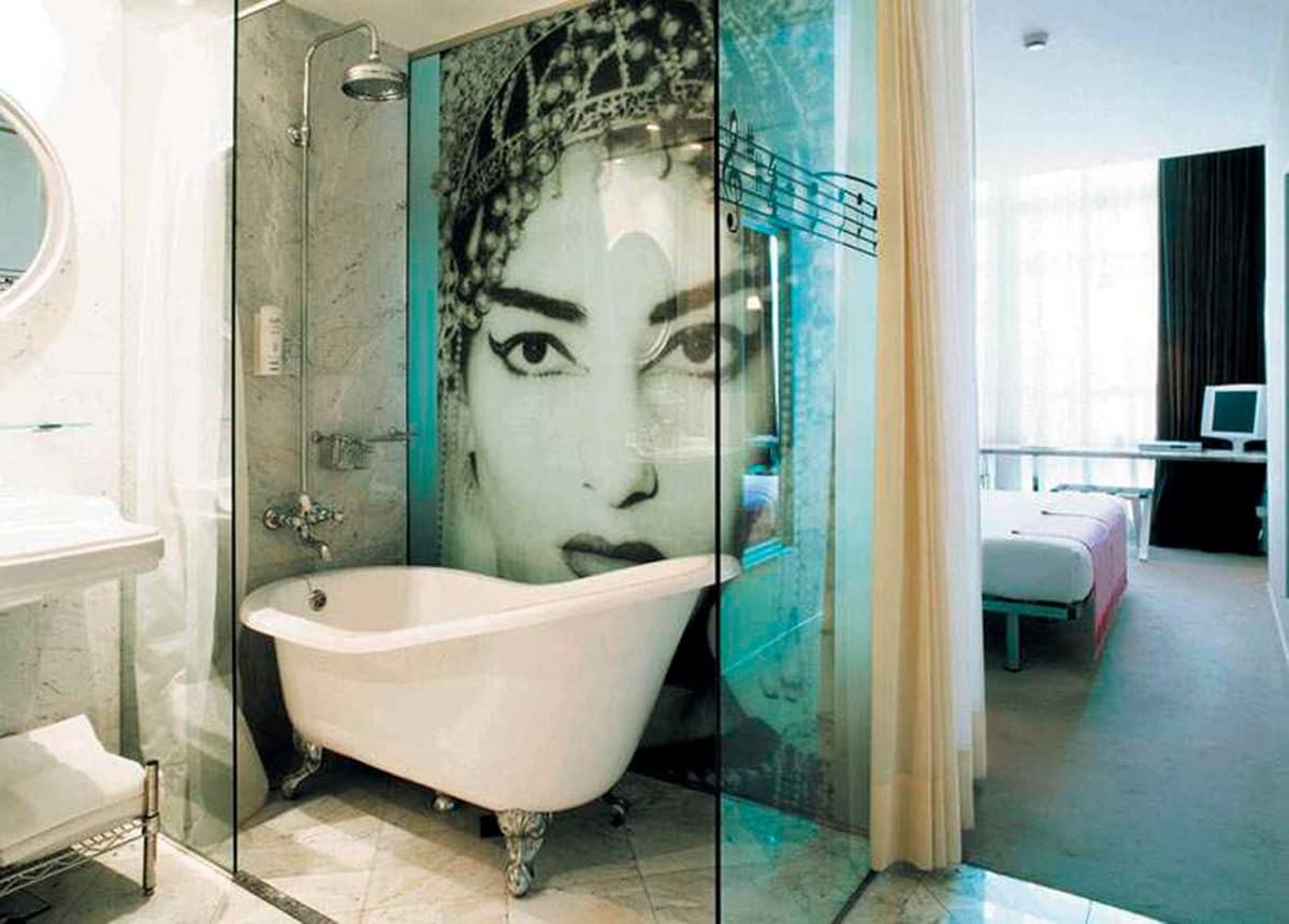 Vasca da bagno in ghisa per centro stanza idfdesign - Paraspruzzi per vasca da bagno ...