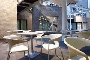 Terrasse, Poltroncina moderna con forme sinuose, per giardini e cortili