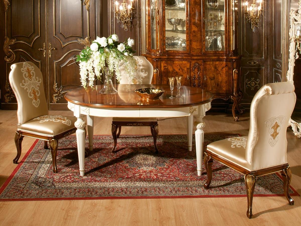 Tavolo ovale con piano in noce, finiture in oro  IDFdesign