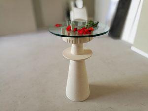 Agor�, Tavolo con piano in cristallo, base in pietra scolpita