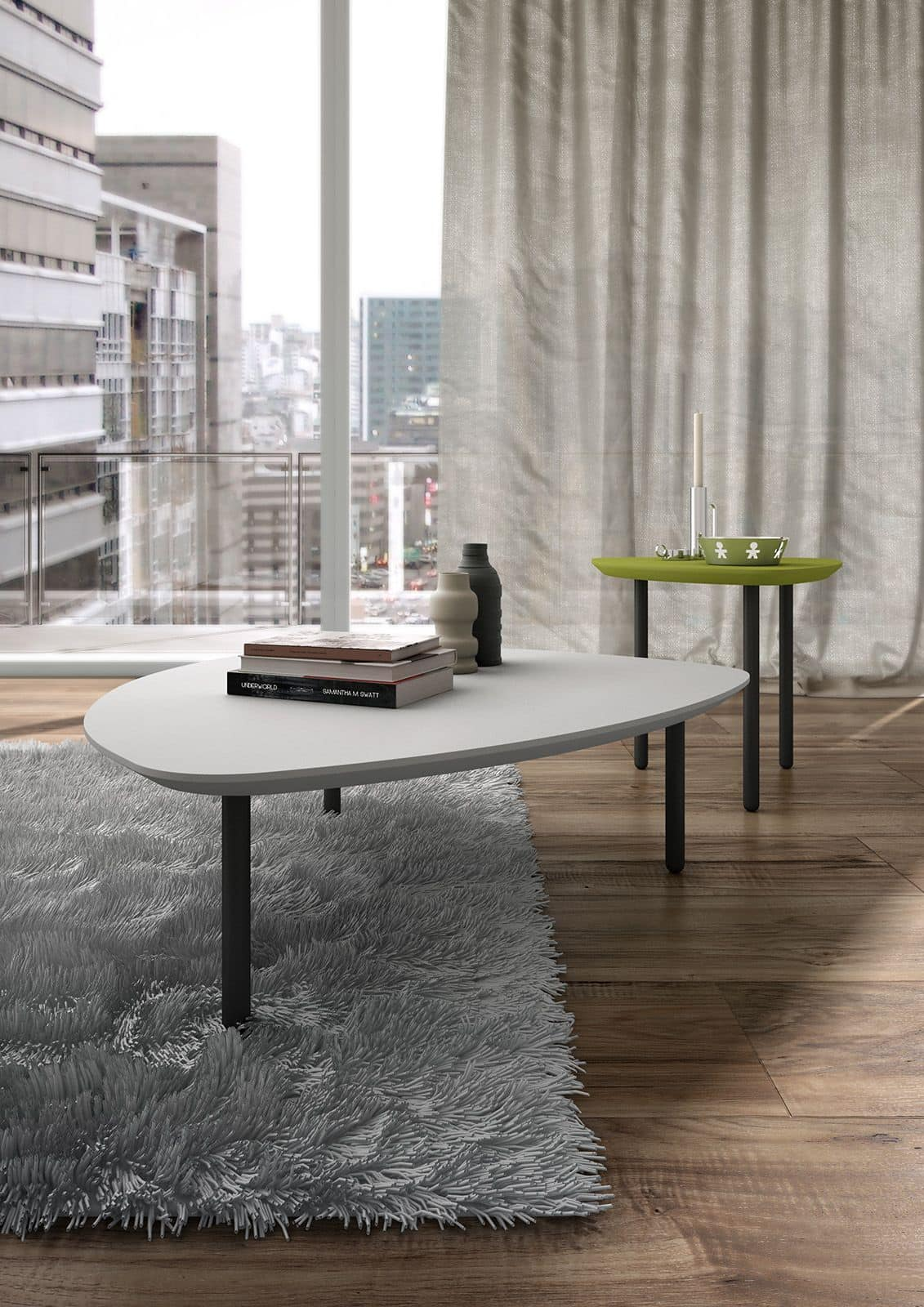 Eos, Tavolino dalla forma triangolare con angoli arrotondati